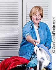 Mature Woman doing laundry