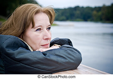 Mature woman dreaming - Portrait of attractive mature woman...