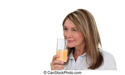 Mature woman drinking fruit juice