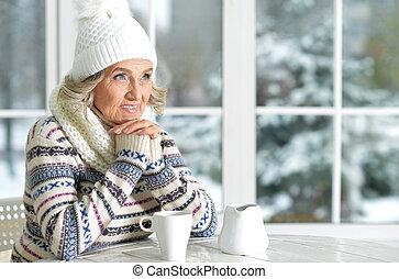 mature woman drinking tea