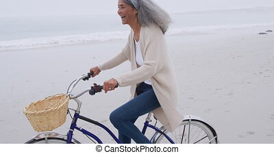 Mature woman enjoying time outside by the sea