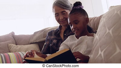 Mature woman enjoying time with her granddaughter