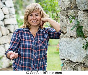 mature woman garden