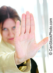Mature woman gesturing stop