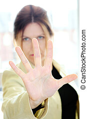 Mature woman gesturing stop with palm of her hand