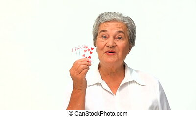 Mature woman holding cards