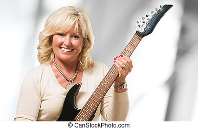 Mature Woman Holding Guitar
