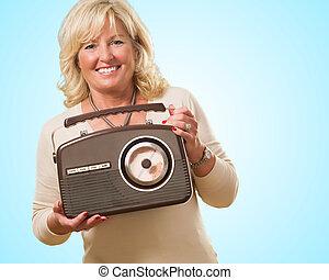 Mature Woman Holding Vintage Radio