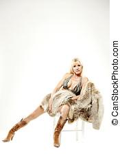 Mature woman in bikini cowboy boots