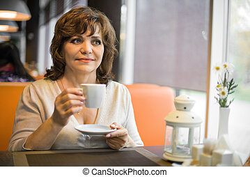 mature woman in Cafe