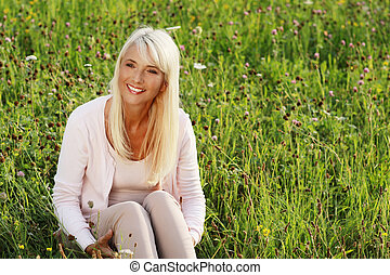 Mature woman in flower field