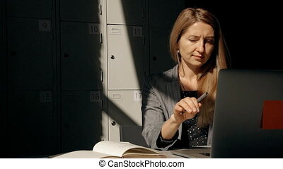Mature woman in formal wear clothes working on laptop -...