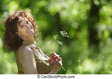 Mature woman in nature - Middle aged mature woman enjoying...