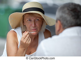 Mature woman in outside cafe