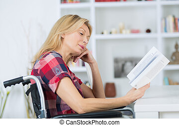 mature woman in wheelchair reading