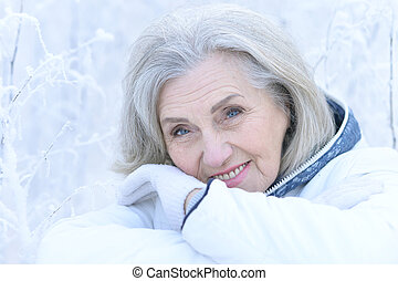 mature woman in winter posing outdoors