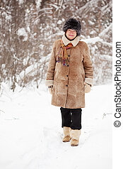 mature woman is walking at winter park