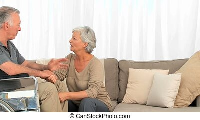 Mature woman listening to her husband