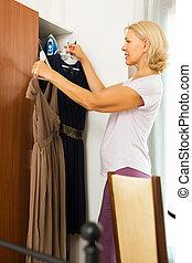 Mature woman looking at clothes