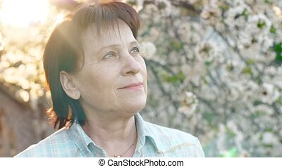 Mature Woman Looking Forward at the Sky