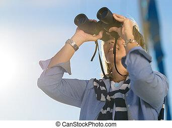 Mature Woman Looking Through Binocular
