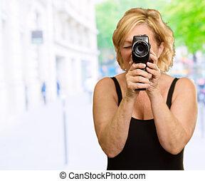 Mature Woman Looking Through Camera