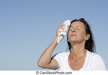 Mature woman menopause stress sweating - Portrait of ...