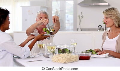 Mature woman offering meal to her
