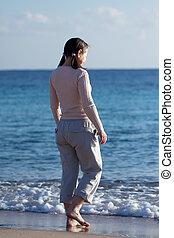 mature woman  on  beach