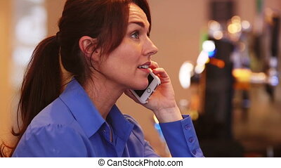 Mature Woman on the phone - Mature woman talking on the...