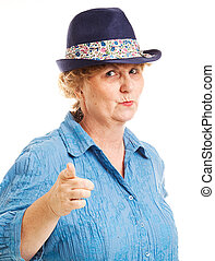 Mature Woman Points at Camera - Portrait of a mature woman...