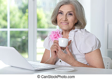 mature woman portrait using laptop