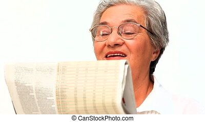 Mature woman reading the newspaper