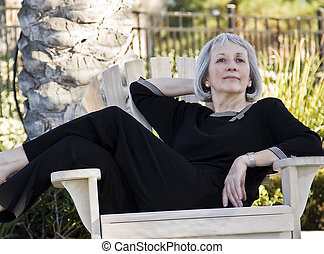 Mature woman relaxing outdoors