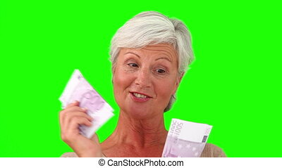 Mature woman showing us her cash