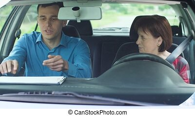 Mature woman takes a driving test