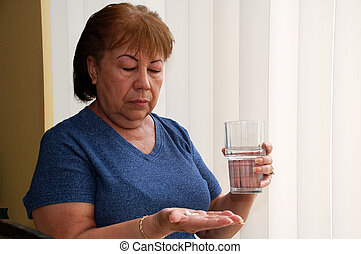 Mature woman taking pills