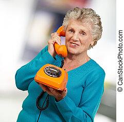 Mature Woman, Talking On Telephone