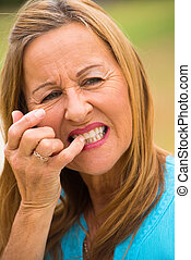 Mature woman toothache outdoor