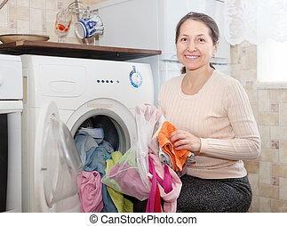 mature woman uses bag for laundry