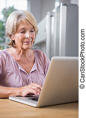 Mature woman using her laptop