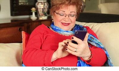 Mature woman using smart phone