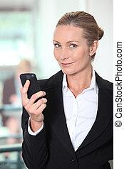 Mature woman using smartphone