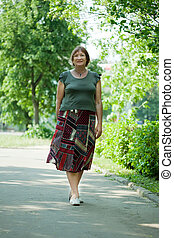 Mature woman walking in  park