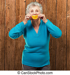 Mature Woman With A Slice Of Fruit