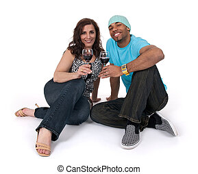 Mature woman with a young man drinking wine