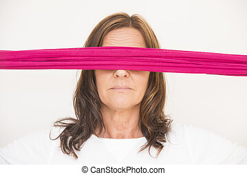 Mature woman with blindfold