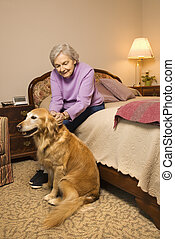 Mature woman with dog.