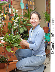Mature woman with  orchid