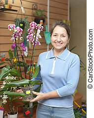 mature woman with Phalaenopsis orchid